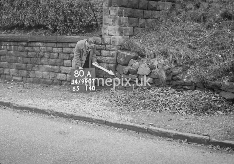 SD990780A1, Man marking Ordnance Survey minor control revision point with an arrow in 1950s