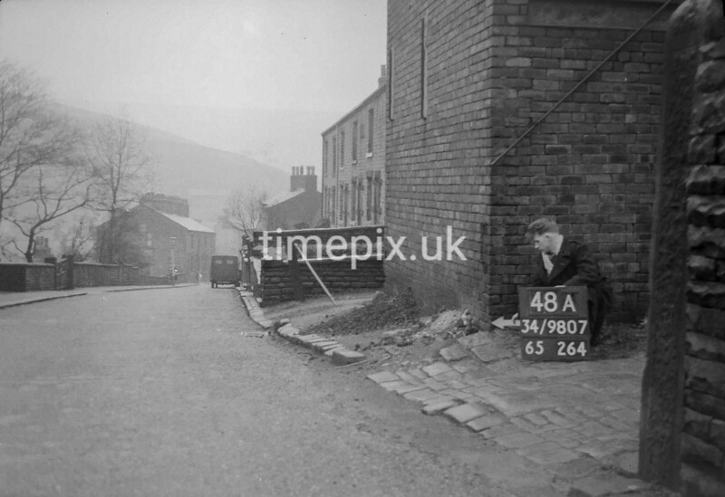 SD980748A, Man marking Ordnance Survey minor control revision point with an arrow in 1950s