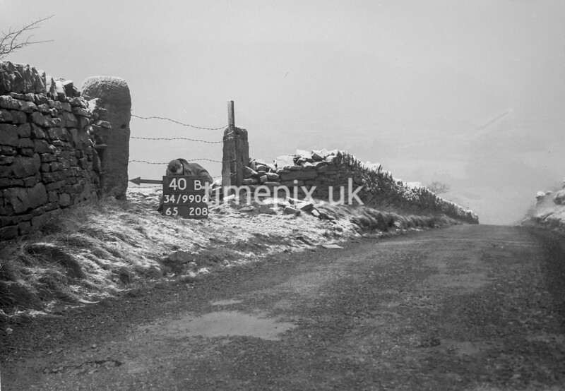SD990640B1, Man marking Ordnance Survey minor control revision point with an arrow in 1950s