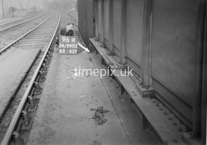 SD990596A2, Man marking Ordnance Survey minor control revision point with an arrow in 1950s