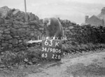 SD980663K, Man marking Ordnance Survey minor control revision point with an arrow in 1950s
