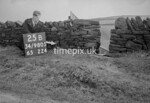 SD980525B2, Man marking Ordnance Survey minor control revision point with an arrow in 1950s