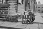 SD990578B, Man marking Ordnance Survey minor control revision point with an arrow in 1950s