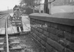 SD990663K1, Man marking Ordnance Survey minor control revision point with an arrow in 1950s