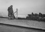 SD990797A, Man marking Ordnance Survey minor control revision point with an arrow in 1950s