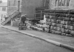 SD990605B2, Man marking Ordnance Survey minor control revision point with an arrow in 1950s