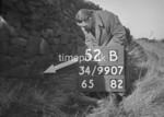 SD990752B, Man marking Ordnance Survey minor control revision point with an arrow in 1950s