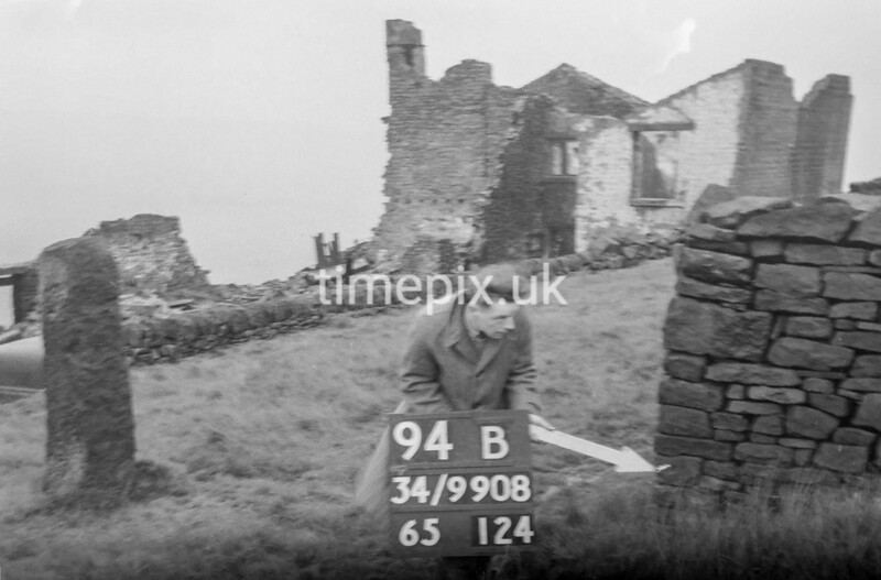 SD990894B, Man marking Ordnance Survey minor control revision point with an arrow in 1950s