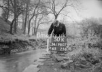 SD980750K, Man marking Ordnance Survey minor control revision point with an arrow in 1950s