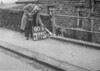 SD990780B1, Man marking Ordnance Survey minor control revision point with an arrow in 1950s