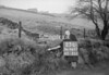 SD980723L, Man marking Ordnance Survey minor control revision point with an arrow in 1950s