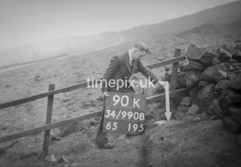 SD990890K, Man marking Ordnance Survey minor control revision point with an arrow in 1950s