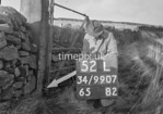 SD990752L, Man marking Ordnance Survey minor control revision point with an arrow in 1950s