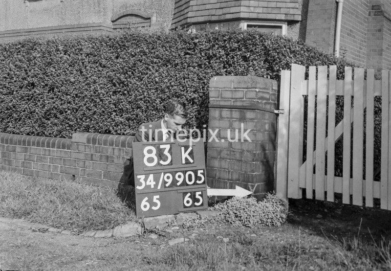 SD990583K, Man marking Ordnance Survey minor control revision point with an arrow in 1950s
