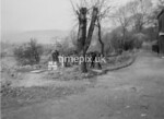 SD980694B2, Man marking Ordnance Survey minor control revision point with an arrow in 1950s