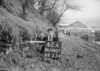 SD980762A, Man marking Ordnance Survey minor control revision point with an arrow in 1950s