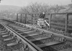 SD990642K3, Man marking Ordnance Survey minor control revision point with an arrow in 1950s