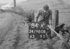 SD980884A2, Man marking Ordnance Survey minor control revision point with an arrow in 1950s