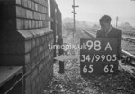 SD990598A, Man marking Ordnance Survey minor control revision point with an arrow in 1950s