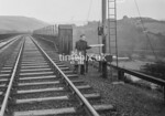 SD990650K, Man marking Ordnance Survey minor control revision point with an arrow in 1950s