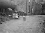 SD980601K, Man marking Ordnance Survey minor control revision point with an arrow in 1950s