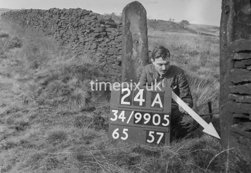 SD990524A, Man marking Ordnance Survey minor control revision point with an arrow in 1950s