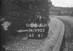 SD990586A, Man marking Ordnance Survey minor control revision point with an arrow in 1950s