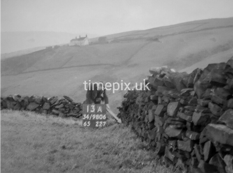 SD980613A, Man marking Ordnance Survey minor control revision point with an arrow in 1950s