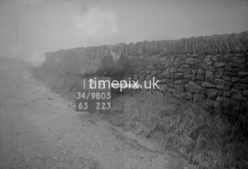 SD980512B, Man marking Ordnance Survey minor control revision point with an arrow in 1950s
