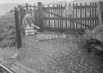 SD990676A, Man marking Ordnance Survey minor control revision point with an arrow in 1950s