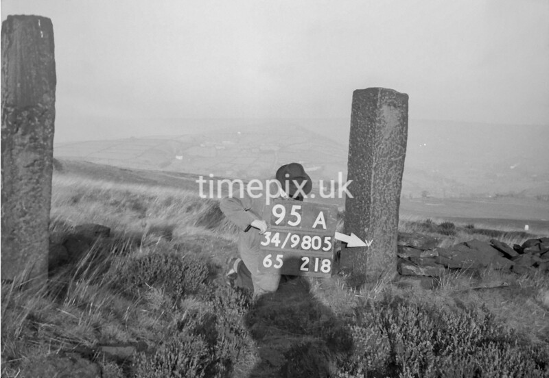 SD980595A, Man marking Ordnance Survey minor control revision point with an arrow in 1950s