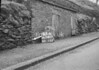 SD990783B, Man marking Ordnance Survey minor control revision point with an arrow in 1950s