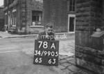 SD990578A, Man marking Ordnance Survey minor control revision point with an arrow in 1950s