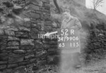 SD990652R1, Man marking Ordnance Survey minor control revision point with an arrow in 1950s