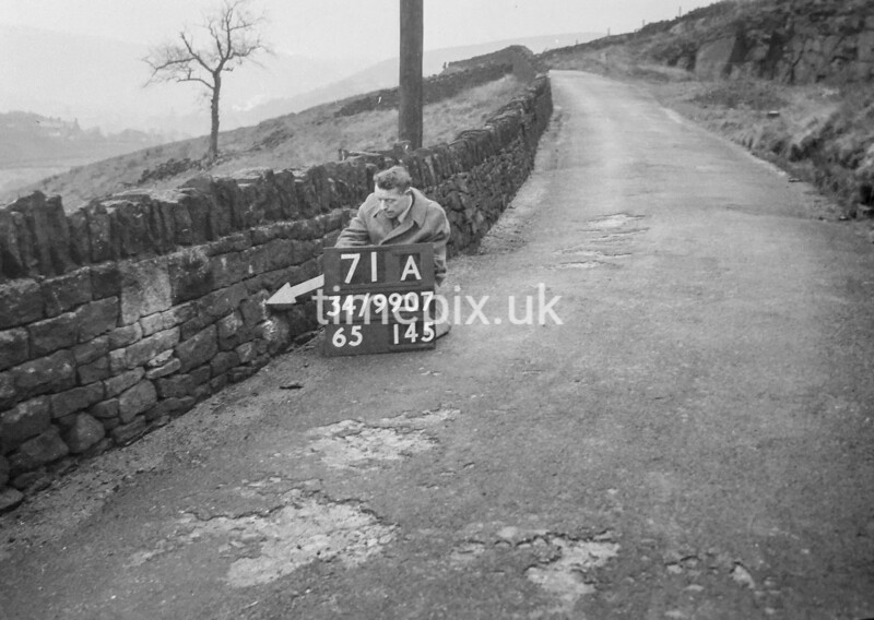 SD990771A1, Man marking Ordnance Survey minor control revision point with an arrow in 1950s