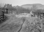 SD980648A, Man marking Ordnance Survey minor control revision point with an arrow in 1950s