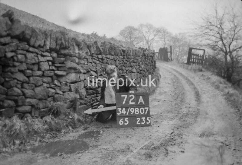 SD980772A, Man marking Ordnance Survey minor control revision point with an arrow in 1950s
