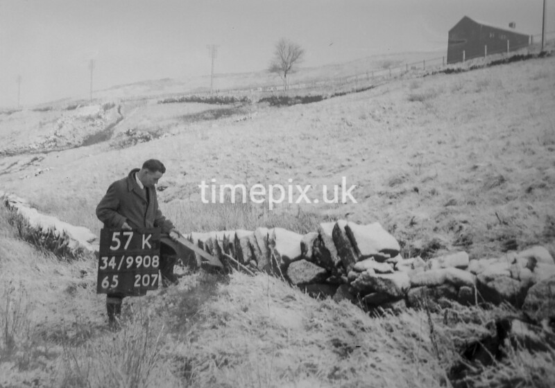 SD990857K, Man marking Ordnance Survey minor control revision point with an arrow in 1950s