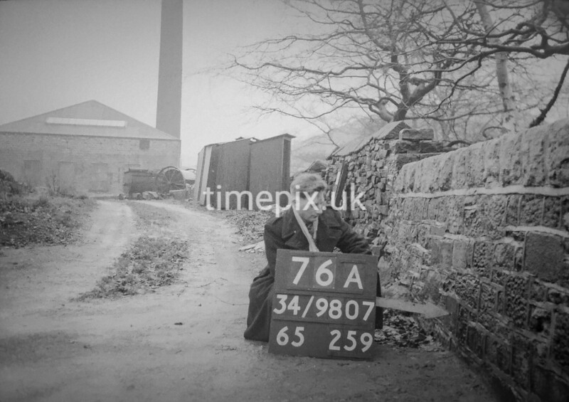SD980776A, Man marking Ordnance Survey minor control revision point with an arrow in 1950s