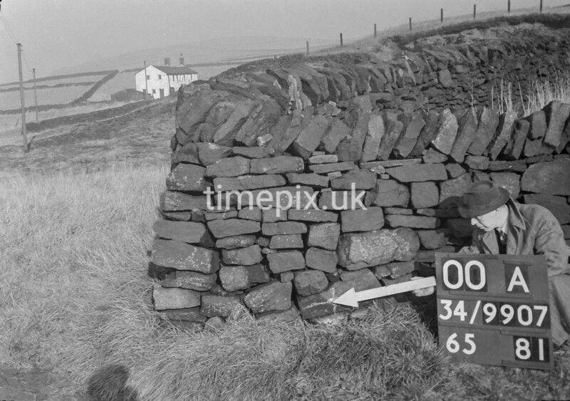 SD990700A, Man marking Ordnance Survey minor control revision point with an arrow in 1950s