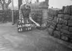 SD990674L, Man marking Ordnance Survey minor control revision point with an arrow in 1950s