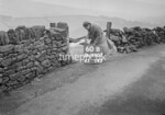 SD990760B2, Man marking Ordnance Survey minor control revision point with an arrow in 1950s