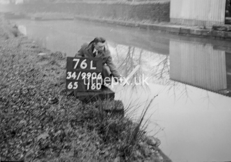 SD990676L, Man marking Ordnance Survey minor control revision point with an arrow in 1950s