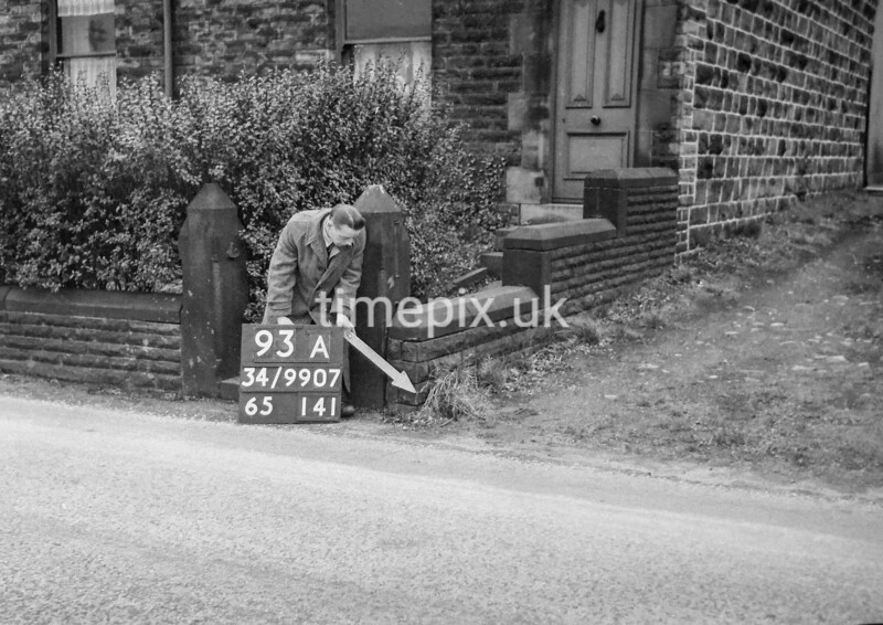 SD990793A1, Man marking Ordnance Survey minor control revision point with an arrow in 1950s