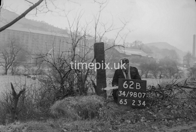 SD980762B, Man marking Ordnance Survey minor control revision point with an arrow in 1950s