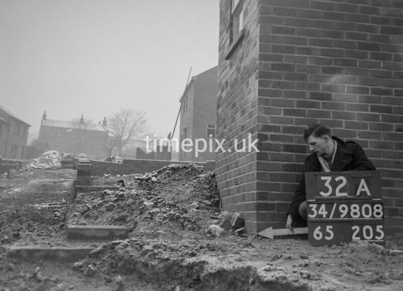 SD980832A, Man marking Ordnance Survey minor control revision point with an arrow in 1950s