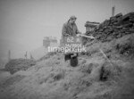 SD980662A, Man marking Ordnance Survey minor control revision point with an arrow in 1950s