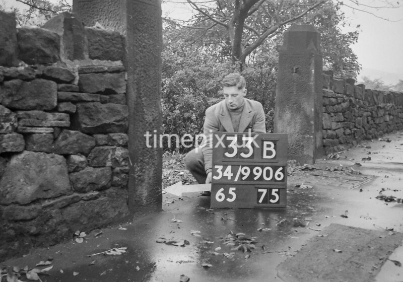 SD990633B, Man marking Ordnance Survey minor control revision point with an arrow in 1950s