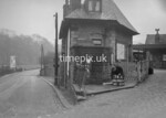 SD980774A, Man marking Ordnance Survey minor control revision point with an arrow in 1950s