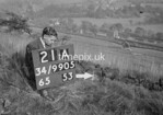 SD990521A1, Man marking Ordnance Survey minor control revision point with an arrow in 1950s